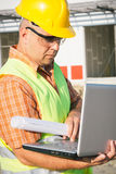 Construction Worker Using Laptop Royalty Free Stock Images