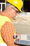 Construction Worker Using Laptop Stock Photo