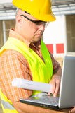 Construction Worker Using Laptop Stock Images