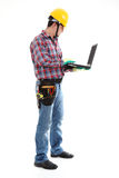Construction Worker using Laptop. On the white background. Isolated on white stock photos