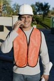 Construction worker using mobile phone Royalty Free Stock Photo