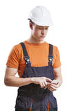 Construction worker using mobile phone Stock Photos