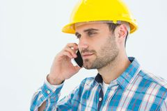 Construction worker using mobile phone. Male construction worker using mobile phone against white backgorund Stock Image