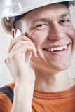 Construction worker using mobile phone Royalty Free Stock Image
