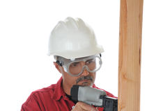 Construction Worker Using Nail Gun Stock Images