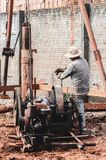 Construction worker using a pile driver. Bate-estacato dig the soil and make the foundation to support the building. Strauss piledriver driven by a motor stock photo