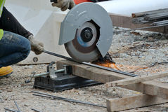 A construction worker using the portable all purpose pipe cutter machine Stock Photo