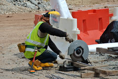 A construction worker using the portable all purpose pipe cutter machine Royalty Free Stock Photography
