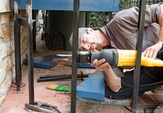 Worker Cutting Wrought Iron Post Royalty Free Stock Photo