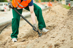 Construction worker using spade Stock Photo