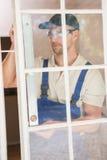 Construction worker using spirit level Stock Photo