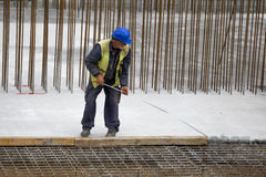 Construction worker using tape measure Stock Image