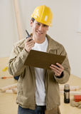 Construction worker using walkie talkie stock photography