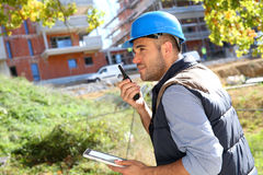 Construction worker with walkie-talkie Royalty Free Stock Photography