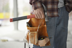 Construction Worker Wearing Tool Belt Stock Photo