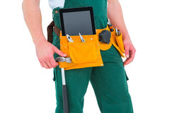 Construction worker wearing tools belt Royalty Free Stock Photography
