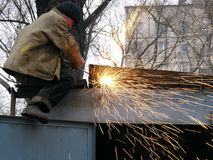 A construction worker welding steel stock image