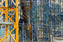 A Construction Worker welding steel bars. A Construction Worker welding steel bars on scaffold in construction site Royalty Free Stock Photos