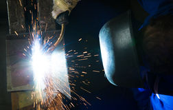 Construction worker welding steel seen from above Stock Images