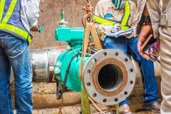 Construction worker welding underground valve gas Stock Photos
