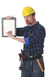 Construction worker wonderfully looking on documen Stock Photos
