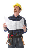 Construction worker wonderfully looking up. With architectural plans stock image