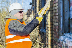 Construction worker with a wooden board near building Royalty Free Stock Photos