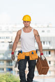 Construction Worker At Work With Brick Royalty Free Stock Image