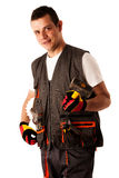 Construction worker in work dress isolated over white Royalty Free Stock Photos