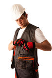 Construction worker in work dress isolated over white background Stock Images