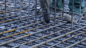 Construction worker. Worker in the construction site making reinforcement metal framework for concrete pouring Royalty Free Stock Photo