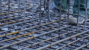 Construction worker. Worker in the construction site making reinforcement metal framework for concrete pouring Stock Photography