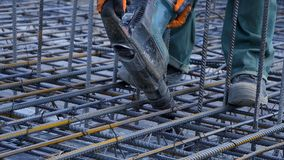 Construction worker. Worker in the construction site making reinforcement metal framework for concrete pouring Royalty Free Stock Photos