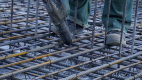 Construction worker. Worker in the construction site making reinforcement metal framework for concrete pouring Stock Images