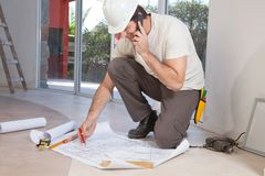 Construction worker working on blueprint Stock Photography