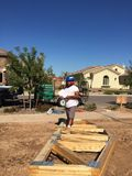 Construction worker working on the framing process for a new a house Stock Photo