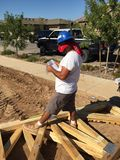 Construction worker working on the framing process for a new a house. Royalty Free Stock Photos
