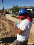 Construction worker working on the framing process for a new a house. Royalty Free Stock Image