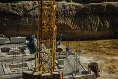 Construction worker working hard on a construction site. Top view Royalty Free Stock Image