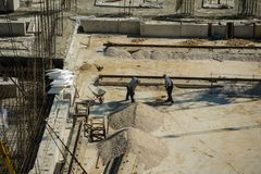 Construction worker working hard on a construction site. Top view Royalty Free Stock Photo