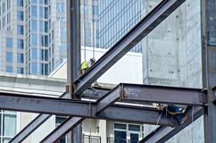 Construction worker working on highrise building Stock Image
