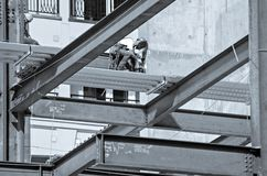 Construction worker working on highrise building Stock Photo
