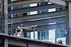 Construction worker working on highrise building Royalty Free Stock Images