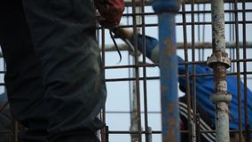 Construction worker working on a construction site. Clip. Employee works at the construction site.  Stock Photo