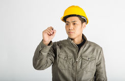 Construction worker writing notes. Male construction worker over white background, writing notes Stock Photography