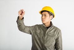 Construction worker writing notes. Male construction worker over white background, writing notes Stock Photos