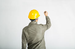 Construction worker writing notes. Male construction worker over white background, writing notes Royalty Free Stock Image