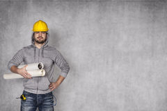 Construction worker. Yellow helmet on his head royalty free stock photography
