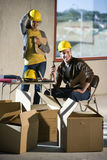 Construction workers. Two young construction workers at a job site Royalty Free Stock Image