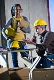 Construction workers. Multi-ethnic male and female construction workers on site Royalty Free Stock Photography